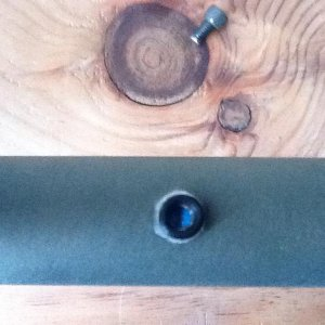 a view of the lever when the adjustment screw is out.