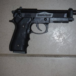 HFC M9A1    Pretty much stock, with KJW Grips. It had a single layer of black painted over the original finish by TheTJ.