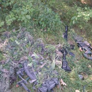 This is a picture of my current ghillie set up, a ATACS FG, Viper hood by tactical concealment, and a map pack with ghillie attached, the rifles in...