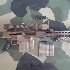 My first attempt at painting M90K our teams tan coloured uniform!    Also debuting they P* Barrett!     Currently configured with short barrel, I do...